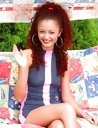 Curly redhead has fun outdoor...