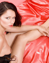Fabulous girl on satin sheets wears red lipstick and makes lusty faces