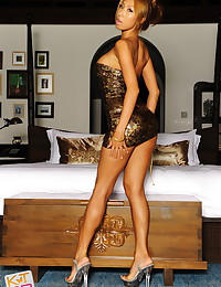 Kt So is long legged in heels and sexy in her beautiful skimpy dress