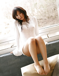 Young Japanese beauty teases