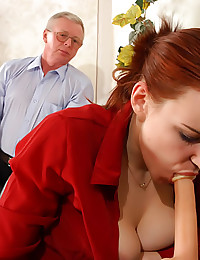 Young sec plays with a dildo in front of her boss
