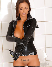 Latex girl has big titties