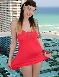 Ivy Snow looks hot in a red dress but soon she is masturbating on a balcony for everyone to see