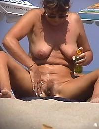 Voyeured close-ups from nude beach
