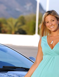 Lia 19 - Sexy blonde posing in a dress by the expensive car