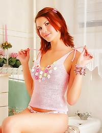 Teen redhead in pink sweater