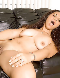 Latina on couch with a toy