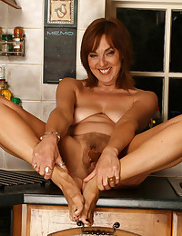 Mature hairy solo in kitchen