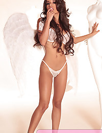Angel wings and an incredible sheer white bra and panty set on model Lupe Fuentes