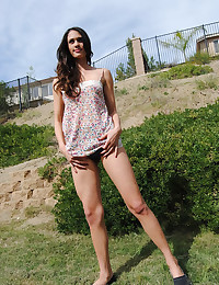 Leggy Cutie Bends Over To Tease