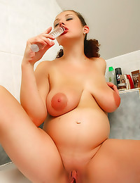 Pregnant toying in the bathroom