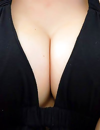 Smiling milf in black dress