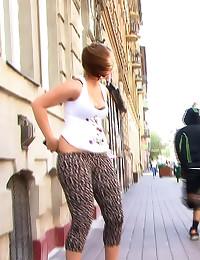 He pulls her pants down