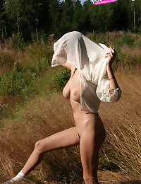 Felicity Fey - Amazingly pretty young lady naked on the field