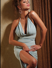 Alley Baggett looks glamorous in a skimpy dress and fingers her box