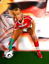 Pigtailed soccer girl is spor...