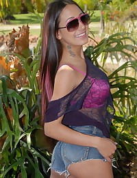 Cute chick in pink bra outdoors