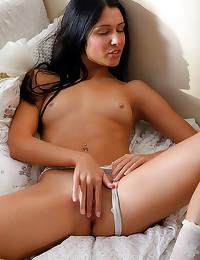 Delicate white lingerie on be...