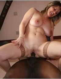 Woman sucking very long black cock.