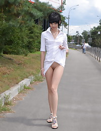 Anya is looking hot in her white button up dress today.