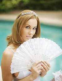 Anita Dark charms you in wedding lingerie and heels as she poses poolside