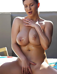 Sara Stone lubes up tits outd...