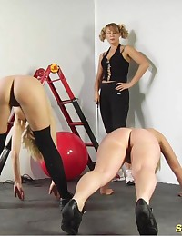 Obedient sexy slaves of a strict female trainer