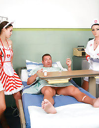 Three nurses play with him