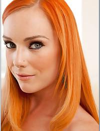 Fiery Redhead Dani Flaunts Her Ass