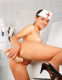 Nurse with a toy fucks pussy