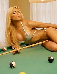 Blonde plays pool in a bikini