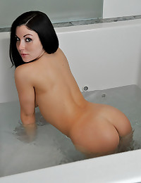 Busty babe in bathtub
