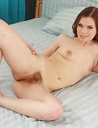 Leggy Brunette Cutie Spreads Hairy Pussy