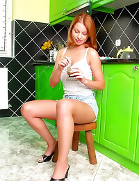 Cute redhead gets creamy in k...