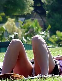 Up skirt in the park. Young hottie voyeured