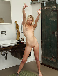 Hot blonde slut playing with two dildos.