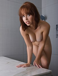 Voluptuous ginger gets in the shower for us.