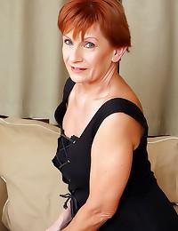 Granny redhead strips nude