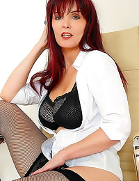 Milf redhead in fishnet stock...