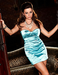 The strapless dress is made from shiny satin and looks so glamorous