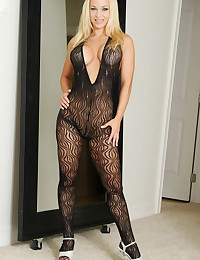 Stunning black lingerie clings to the body of beautiful Jenny Poussin