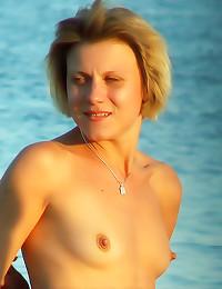 Small tits girl at public bea...