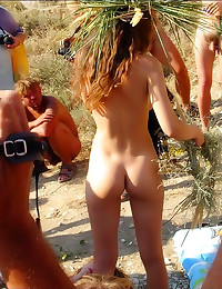 Painting nude bodies at beach