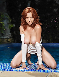 Stunning ginger gets in the pool completely naked.