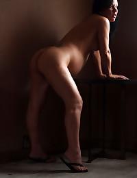 Preggo brunette shows off her hot legs.