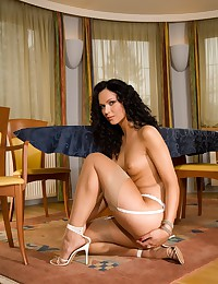Sexy amateur brunette shows her legs in tan stockings