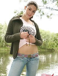 Busty Alli - Fantastic young broad teases and poses outdoors