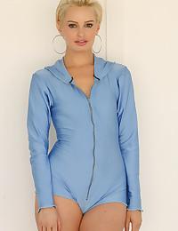 Kara is looking hot as hell in her blue zip up romper today.