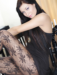 Pantyhose and a little black dress look good on the brunette beauty