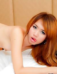 Sexy redhead ladyboy boned in...